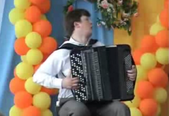 Many people can play the accordion, but this boy is a genius