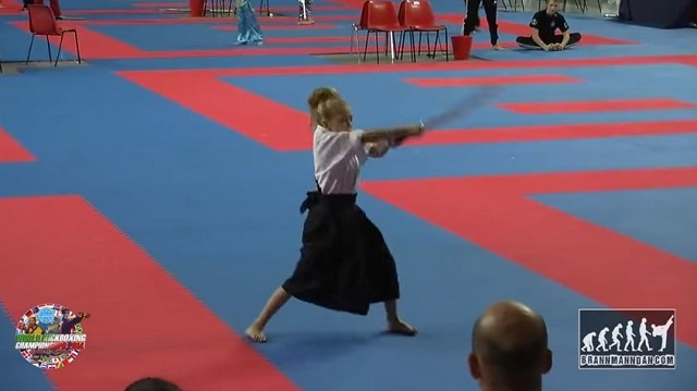 The energy of this little girl amazes a whole audience. Watch how she handles her sword!