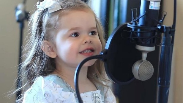 Father asks his daughter to sing for being recorded. Her performance is simply adorable!