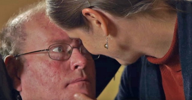 He hasn't talked for almost a year, but watch what happens when he looks into his wife's eyes