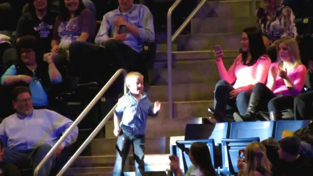 The parents take their child to a concert of their favorite musical group. What the cameras record is unforgettable
