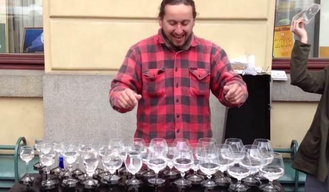 He arranged some glasses filled with water on a table; watch what he's doing - it's wonderful